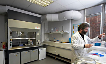 Chemist analysing flavour materials in the manufacture of certified flavour standards